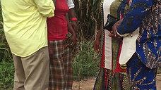 Bishop Davis & Pastors at Word of God Triumphant praying for a deaf woman