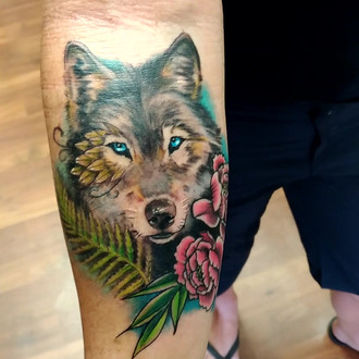 17598d3bffc05 Read more Colour wolf portrait with flowers and plants by Kelsey Bareham.  Whistler Tattoo