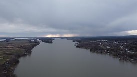 Cloudy/Rainy Skies Over River