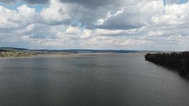 Cumulus Clouds and River