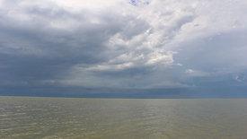 Cloudy Skies Over Lake