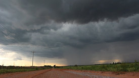 Stormy Skies Over Red Dirt Road