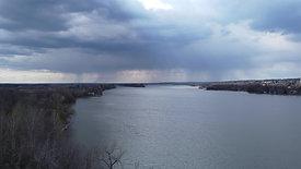 Rainy Skies Over River
