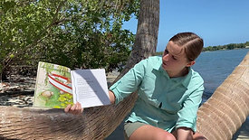 Emily reading Sam the sea cow by Francine Jacobs