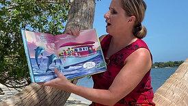 Mrs. Howard reading A Dolphin's Wish