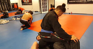 Purple Belt Brandon Costa and other students rolling...