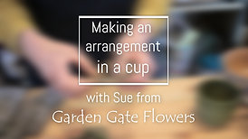 An arrangement in a cup