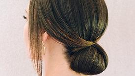 Low Sleek Bun by Stephanie Brinkerhoff