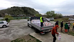 Bringing food to gypsy village in Shkoder