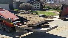 Driveway and Brick Facade Removal