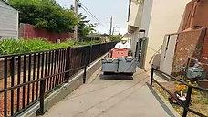 Brick Veneer Down Narrow Walkway