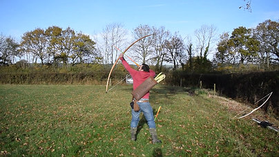 Joe shooting a 170lb American Yew Warbow. In less than ideal conditions 80 gram arrows were landing over 300 yds away.