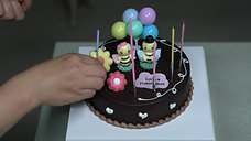 Candles Get Set In Birthday Cake