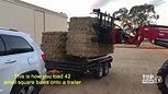Loading 42 bales (2 Packs) onto a trailer.