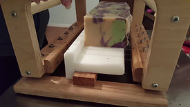 Cutting logs into bars of soap