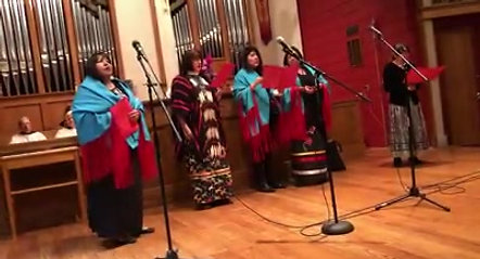 "The Rev. Dr. Mary Crist and the First Women First Tuesday Native American Talking Circle singing a verse of ""Amazing Grace"" in the Lakota language"