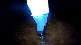 wet denim skirt and wet rubber boots