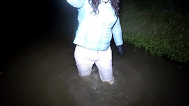 WetLook 240 girl in white jeans and rubber boots in deep water