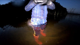 WetLook 239  girl in shorts and rubber boots in deep water