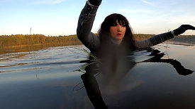 WetLook 210 girl in overalls and rubber boots in the water