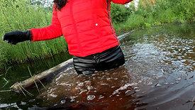 WetLook | Girl in waders and leather pants in deep mud