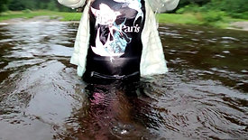 WetLook 198, Girl in Shorts and High Leather Boots in Water