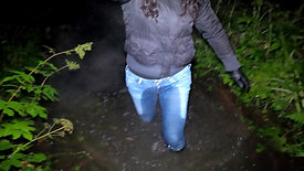 WetLook 206 girl in wet jeans and rubber boots in a deep swamp
