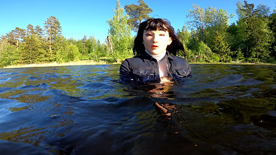 WetLook | Girl in jeans and rubber boots in deep water