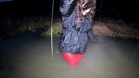 Girl in leather boots and leather skirt in deep water