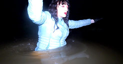 WetLook 241 girl in white jeans and rubber boots in deep water