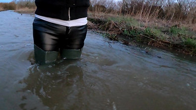 Wetlook 226 Girl in leather pants and waders in deep water