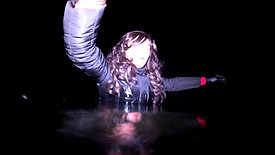 WetLook 211 girl in jeans and rubber boots in the water