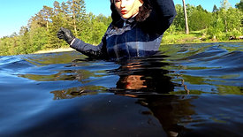 WetLook 230 Girl in jeans and rubber boots in deep water