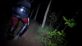 Girl in a wet leather skirt and wet high leather boots in the mud