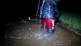 Girl in a leather skirt and high leather boots in deep water