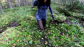 WetLook 207 girl in denim overalls and rubber boots in the mud