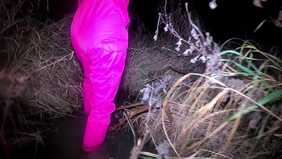 WetLook 212 Girl in pink overalls and rubber boots in the water