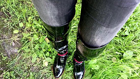 Girl in jeans and high leather boots in the mud