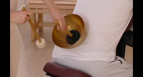 Massage sonore assis