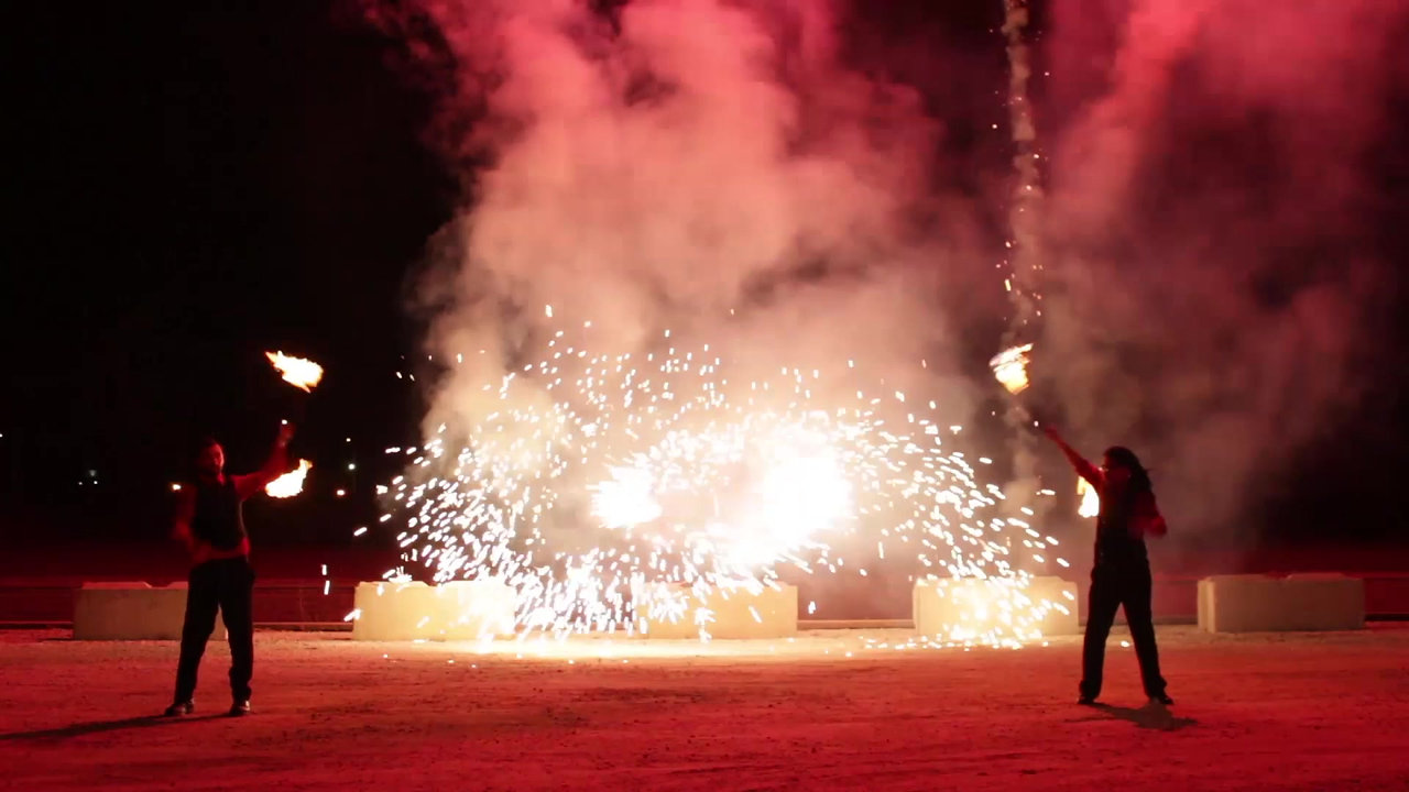 IgNitE: A Fire Dance and Fireworks Spectacle