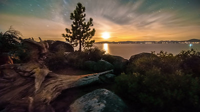 nimia_92152_Timelapse_dolly_shot_of_Lake_Tahoe_from_Sand_Harbor_Nevada_Desert_sunset_with_lens_flare_seen