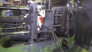 Side view of a tilt casting machine with core pulls