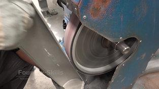 Flash removal with belt grinder