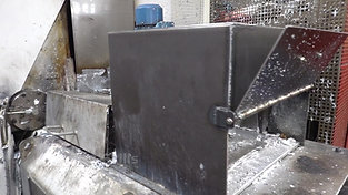 Furnace side of a hot chamber high pressure die casting machine with recirculation material