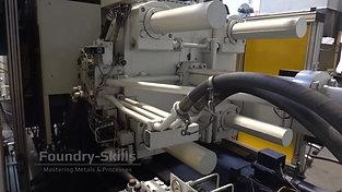 Rear side of a high pressure die casting machine
