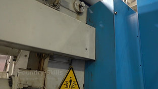 Back side of a larger hot chamber high pressure die casting machine