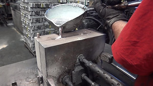 Casting into a hand gravity die with pouring ladle