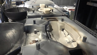 Core insertion in a die from a tilt casting machine