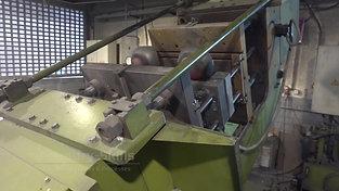 Tilt casting machine during tilting process