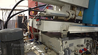Rear side of a hot chamber high pressure die casting machine